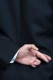 Geschäftsmann liegende gefälschte Finger gekreuzt Lizenzfreie Stockfotografie