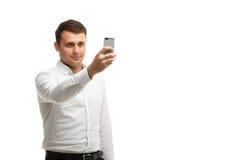 Geschäftsmann macht Foto unter Verwendung des Telefons Stockfotos