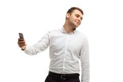 Geschäftsmann macht selfie unter Verwendung des Telefons Lizenzfreie Stockfotografie