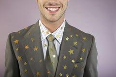 Geschäftsmann-With Many Gold-Sterne auf Klage stockfotografie