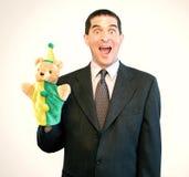 Geschäftsmann-Marionetten-Überraschung Stockfoto