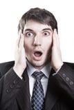 Geschäftsmann mit Überraschungsausdruck auf Gesicht Stockbild