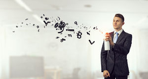 Geschäftsmann mit Aerosoldose Gemischte Medien Lizenzfreie Stockfotos