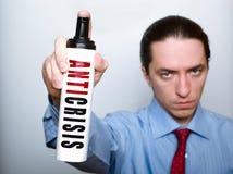 Geschäftsmann mit anticrisis Spray. lizenzfreie stockfotografie