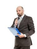 Geschäftsmann mit blauem Ordner Stockfotografie