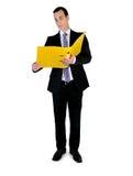 Geschäftsmann mit Datei Stockfotografie