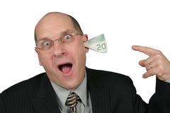 Geschäftsmann mit dem Geld, das aus seine Ohren herauskommt stockfoto