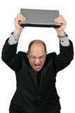 Geschäftsmann mit dem Laptop obenliegend - wütend lizenzfreies stockfoto