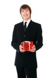Geschäftsmann mit dem roten Geschenk Lizenzfreies Stockbild