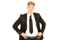 Geschäftsmann mit den Händen auf Hüften Stockfoto
