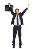 Geschäftsmann mit den Händen oben, wer Aktenkoffer hält stockbilder