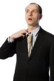 Geschäftsmann mit der Galgengleichheit, die einen Atem nimmt Stockfoto