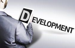 Geschäftsmann mit der Text Entwicklung in einem Konzeptbild Lizenzfreies Stockfoto