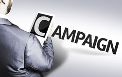 Geschäftsmann mit der Text Kampagne in einem Konzeptbild Lizenzfreies Stockbild
