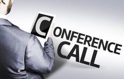 Geschäftsmann mit der Text Telefonkonferenz in einem Konzeptbild Lizenzfreie Stockfotografie