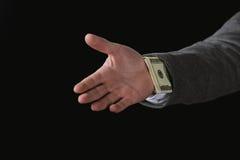 Geschäftsmann mit Dollarbanknoten im Ärmel lokalisiert auf Schwarzem Lizenzfreie Stockfotos