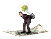 Geschäftsmann mit eco Lampe Stockfotografie