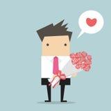 Geschäftsmann mit einem Blumenstrauß Stockfotos