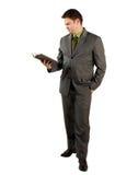 Geschäftsmann mit einem Buch Stockfoto