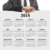 Geschäftsmann mit einem Kalender 2014 Stockfoto