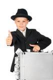 Geschäftsmann mit einem Koffer Geld Daumen zeigend Stockfotografie