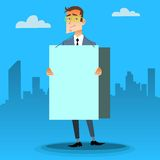 Geschäftsmann mit einem Plakat und Platz für Text Lizenzfreie Stockbilder