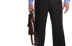 Geschäftsmann mit einem Portefeuille lizenzfreie stockbilder