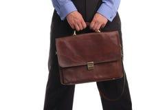 Geschäftsmann mit einem Portefeuille auf einem weißen Hintergrund lizenzfreie stockfotografie