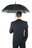 Geschäftsmann mit einem Regenschirm Lizenzfreie Stockbilder