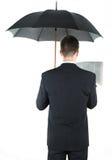 Geschäftsmann mit einem Regenschirm Stockfotos