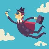 Geschäftsmann mit einem Smartphone fliegt in der Hand durch den Wolkenspeicher Stockfoto