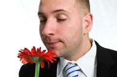 Geschäftsmann mit einer Blume Stockfoto