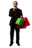 Geschäftsmann mit Einkaufenbeuteln Stockfotografie