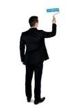 Geschäftsmann mit Farbenrolle Stockfotos