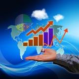 Geschäftsmann mit Finanzsymbolen an Hand Lizenzfreies Stockfoto