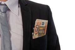 Geschäftsmann mit Geld in seiner Tasche stockbilder