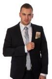 Geschäftsmann mit Geld in seiner Tasche lizenzfreie stockbilder
