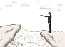 Geschäftsmann mit gezogenem Rand des Berges Stockfoto