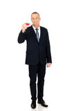 Geschäftsmann mit großem rotem Bleistift Lizenzfreie Stockfotografie