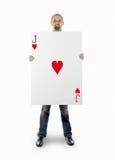 Geschäftsmann mit großer Spielkarte stockbild