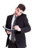 Geschäftsmann mit Handy und Kalender Stockfotografie