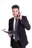 Geschäftsmann mit Handy und Kalender Stockfotos
