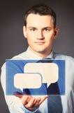 Geschäftsmann mit Ikone Lizenzfreies Stockfoto
