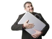 Geschäftsmann mit Koffer Stockbild