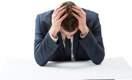 Geschäftsmann mit Kopf in den Händen Lizenzfreies Stockfoto