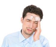 Geschäftsmann mit Kopfschmerzen stockfotografie