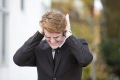 Geschäftsmann mit Kopfschmerzen Stockfotos