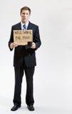 Geschäftsmann mit kranker Arbeit des Zeichens für Nahrung Stockfoto