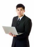 Geschäftsmann mit Laptop Lizenzfreies Stockbild