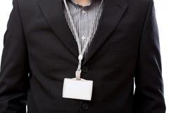 Geschäftsmann mit leerer Identifikations-Karte Stockfotografie